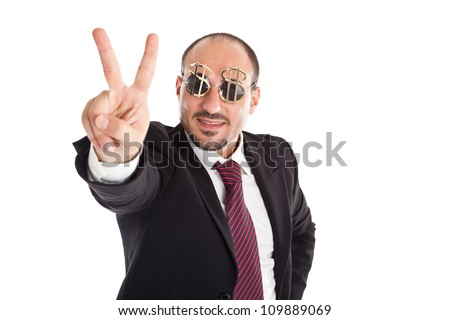 Businessman with dollar-sign glasses standing and showing the win sign - stock photo
