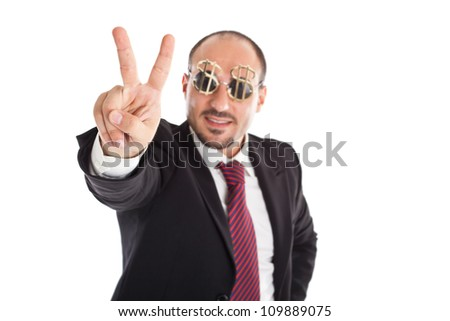 Businessman with dollar-sign glasses standing and showing the win sign. Focus on the hand - stock photo