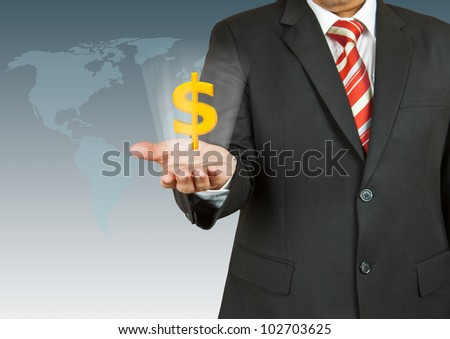 Businessman with dollar symbol over his hand - stock photo