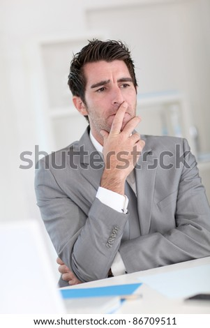 Businessman with doubtful look - stock photo