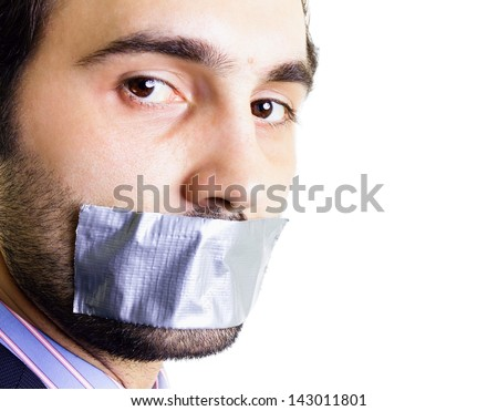 Businessman with duct tape on mouth, white background. Conceptual image. - stock photo