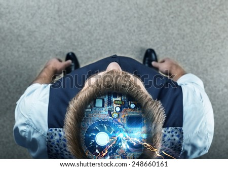 Businessman with electric parts in his head - stock photo