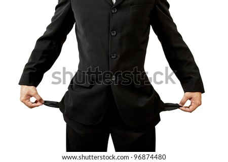 Businessman with empty pockets on white background - stock photo