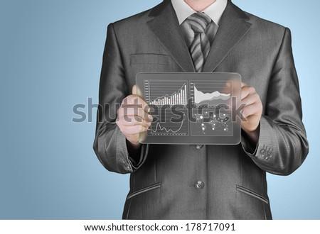 businessman with financial symbols - stock photo