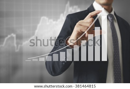 Businessman with financial symbols coming