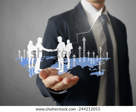 businessman with financial symbols coming from hand  - stock photo