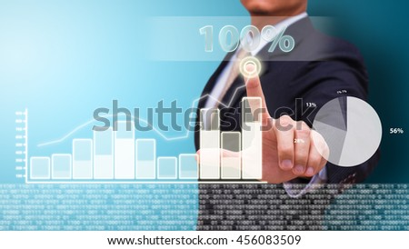 Businessman with financial symbols growing up - stock photo