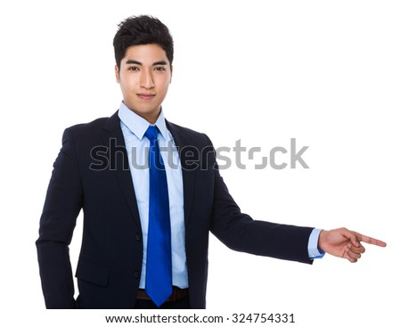 Businessman with finger point aside - stock photo