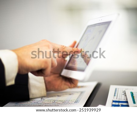 Businessman with finger touching screen of a digital tablet - stock photo