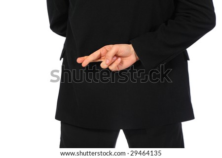 Businessman with fingers crossed behind his back - stock photo