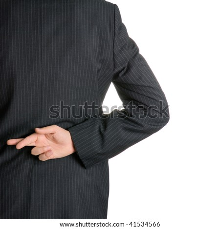 Businessman with fingers crossed behind his back.
