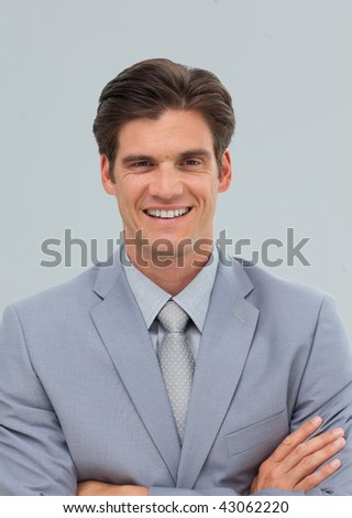 Businessman with folded arms smiling at the camera