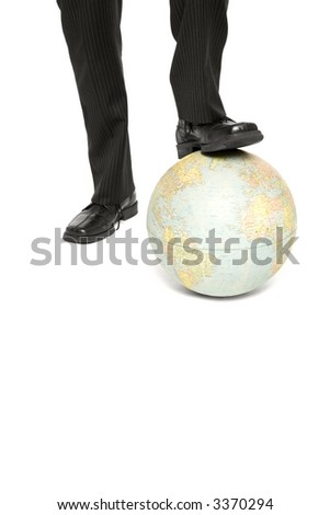 Businessman with foot on globe