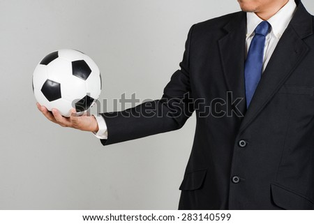 businessman with football - stock photo