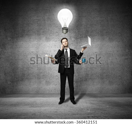 businessman with four hands and lamp over head