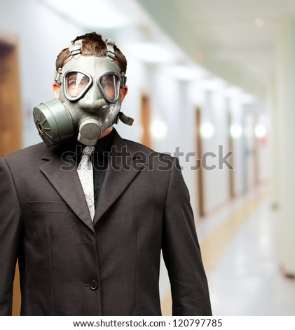 Businessman With Gas Mask, indoor - stock photo