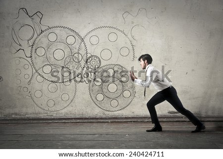 Businessman with gears - stock photo