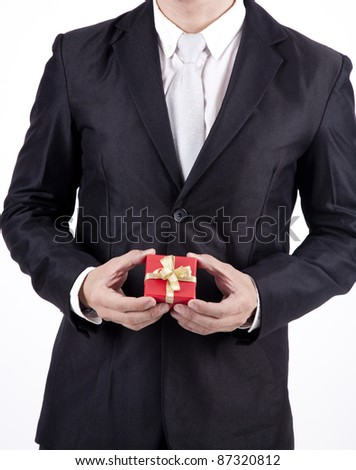 Businessman with gift box isolated on white - stock photo