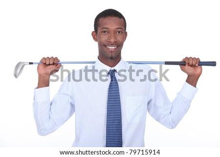 Businessman with golf club - stock photo