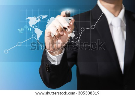 businessman with graph and digital map