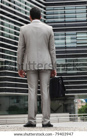 Businessman with gray suit, back view - stock photo