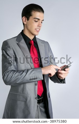 Businessman with gray suit talking cellular phone with suit and red tie
