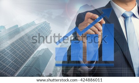 businessman with growth concept chart on urban background