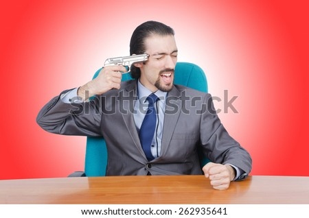 Businessman with gun on white - stock photo