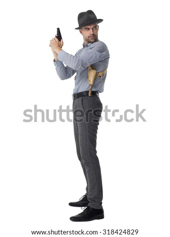 Businessman with gun posing portrait isolated on white background