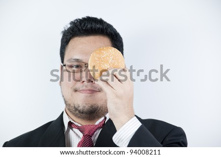 Businessman with hamburger - stock photo