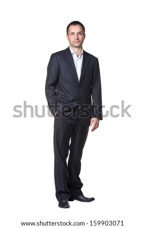 Businessman with hand in pocket full length portrait - stock photo