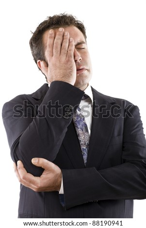 businessman with hand on face, eyes closed by an expression of concern or headache - stock photo