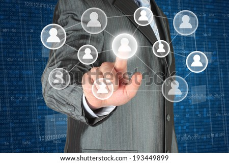 Businessman with hand pressing virtual social media button   - stock photo