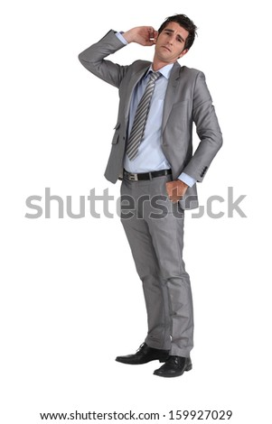 Businessman with hand to ear