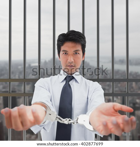 Businessman with handcuffs against new york - stock photo