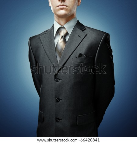 businessman with hands behind - stock photo