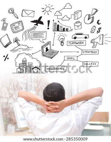 Businessman with hands behind head at desk against brainstorm graphic