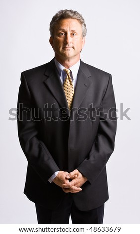 Businessman with hands clasped - stock photo