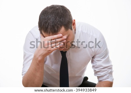 Businessman with headache, white background