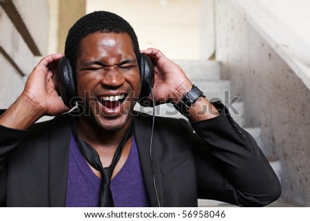 Businessman with Headphones on Screaming - stock photo