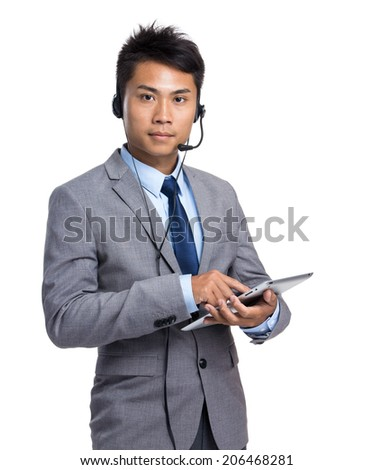 Businessman with headset and digital tablet - stock photo
