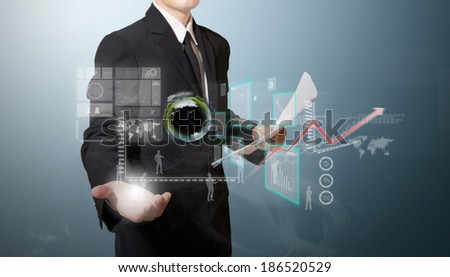 businessman with high technology on hand - stock photo