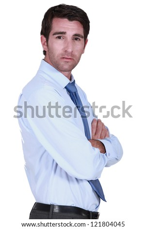 Businessman with his arms crossed - stock photo
