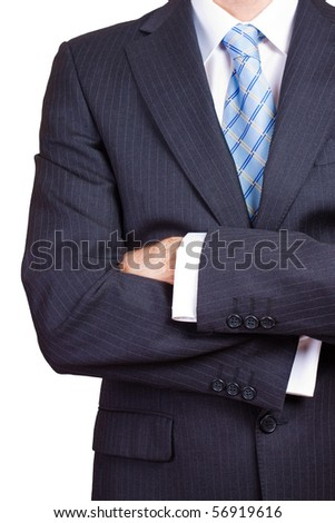 Businessman with his arms crossed against a white background - stock photo