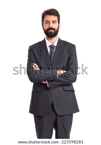 Businessman with his arms crossed over white background