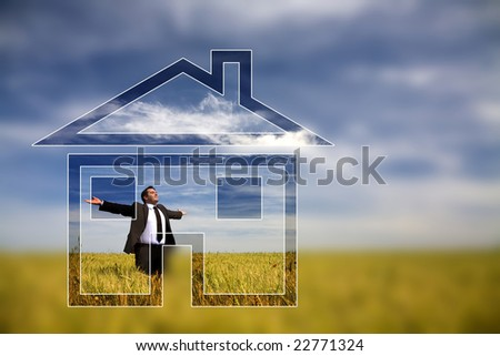 businessman with his arms wide open in rural field with dream house - stock photo