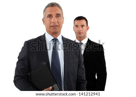 Businessman with his assistant - stock photo