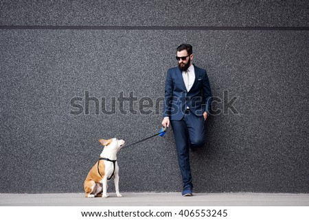 Businessman with his dog. - stock photo