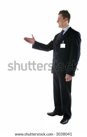 Businessman with his hand out making an introduction, blank ID card. - stock photo