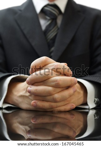 businessman with his hands clasped - stock photo